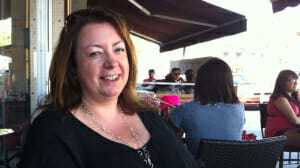 Tracey on a cafe patio.