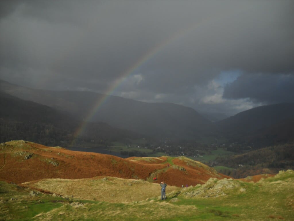 Loughrigg Pike (the real thing) rainbow and all. Falling in Love with the Lake District
