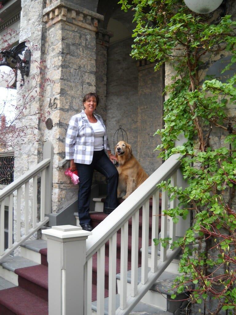 woman with golden retriever dog