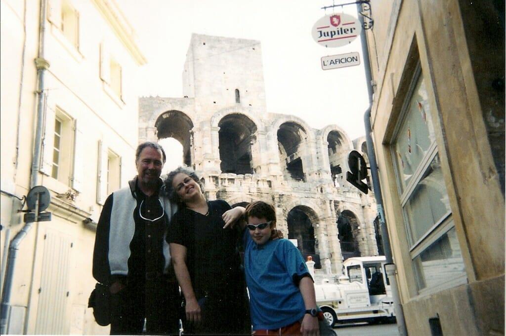 Colisseum in Arles behind 3 people