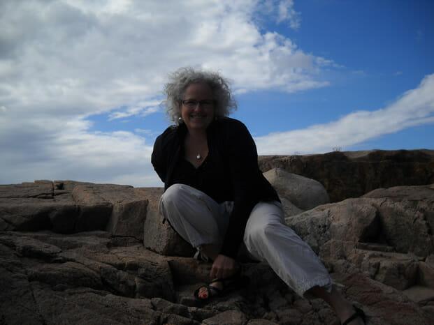 Woman on rocks at ocean shore