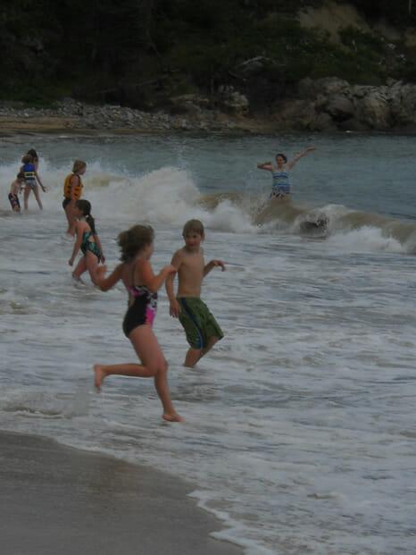 ocean beach kids playing in surf