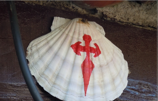 Scallop shell (the logo of the Camino) with cross of St. James