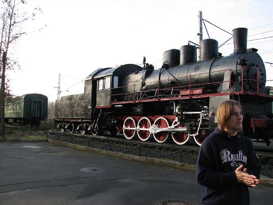 man standing in front of locomotive