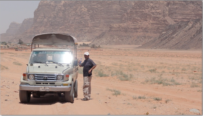 Mahmoud with our four wheel drive in Wad Rum