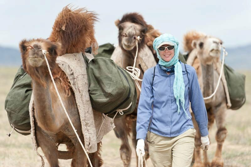 Woman in the Desert with camels