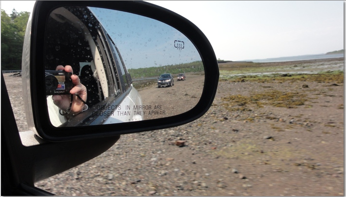 View of land bridge through side mirror