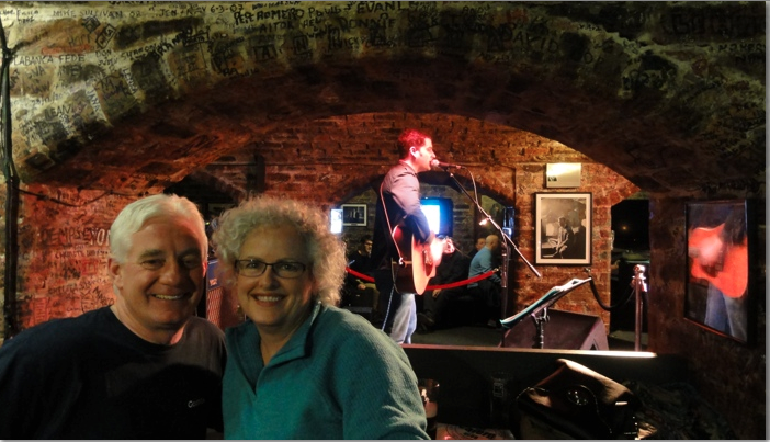 two people in front of stage at Cavern Club Liverpool