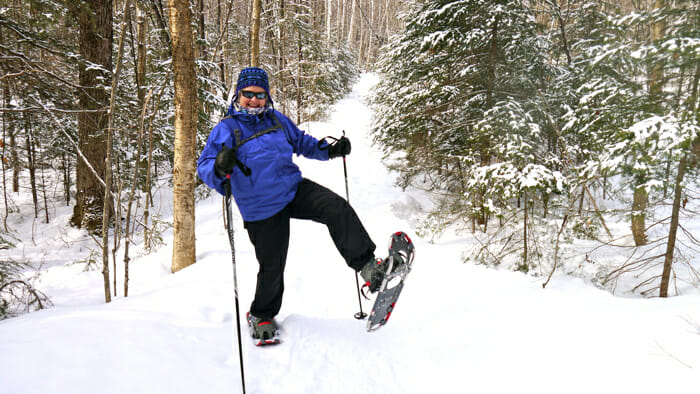 Woman snow shoeing.