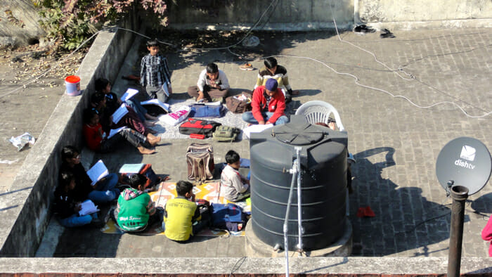 studying on rooftop in India