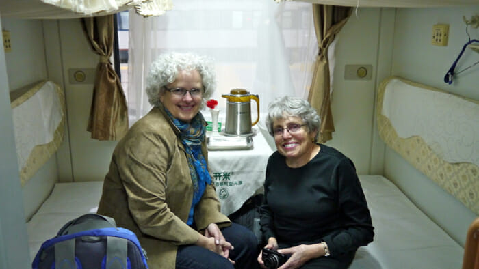 Me and my cabin mate on a train in China.