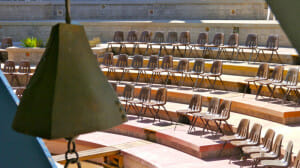 A view of the amphitheater with a bronze bell in the foreground. Most of the cost of Arcosanti is supported by the sale of bells for which they are famous.