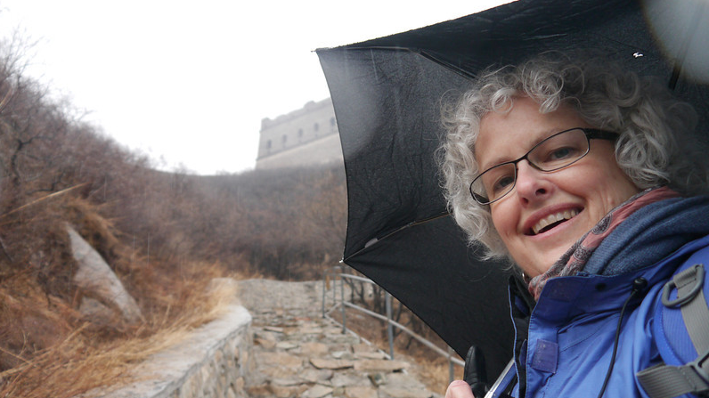 Yes, prepare for all weather possibilities when you pack. We climbed the Great Wall of China in the rain.