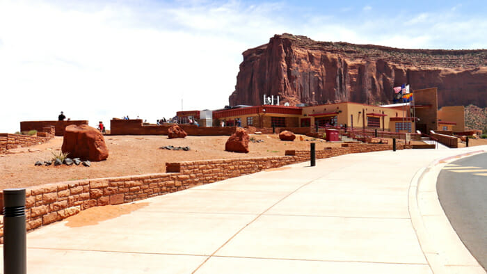 Monument Valley Tribal Park. There main building has a restaurant, gift shop and museum. You can also book tours of the valley from stands in the parking lot.