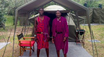 Maasai in front of tent
