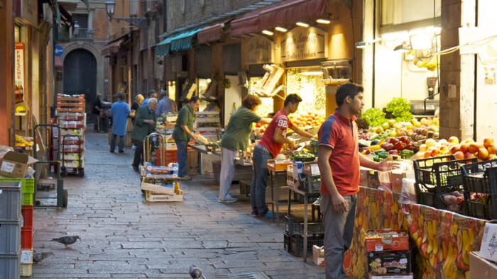 The original market in Bologna is on the Via de Drapperie. You can still go there for fine food. Here the vendors are preparing for day.