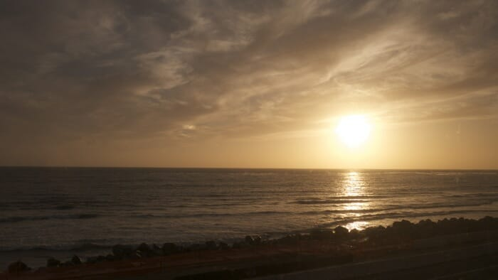 The Coast Starlight train runs along the beach for almost an hour as it approaches LA. This is the sun setting over the Pacific Ocean.