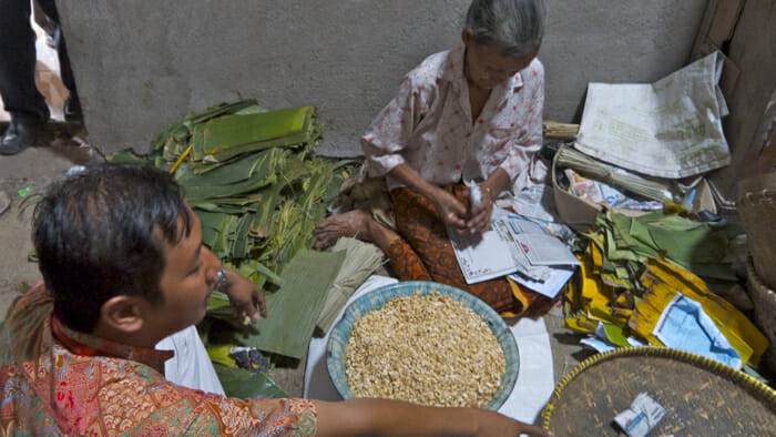 After visiting a temple we toured a small village and popped into a number of homes to learn how local food was made. This woman showed us how tempeh is made.