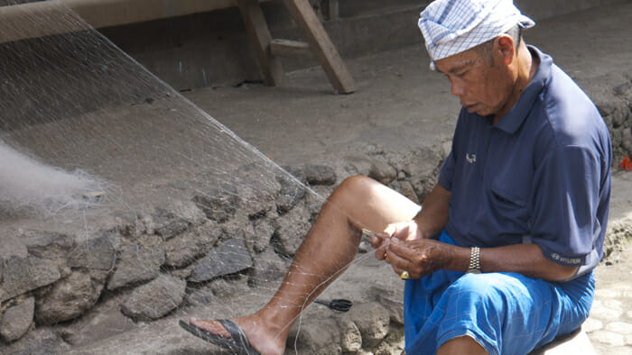 Man making a fishing net in Terunyan Village, ubud