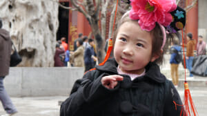 This sweet little girl who posed for me at The Summer Palace in Beijing is positioned using the thirds.