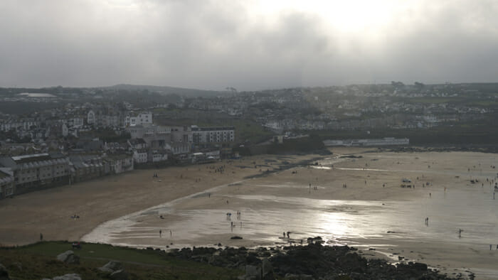 Suddenly, in this cloudy day, the sun broke through just enough to gleam on Porthmeor Beach.