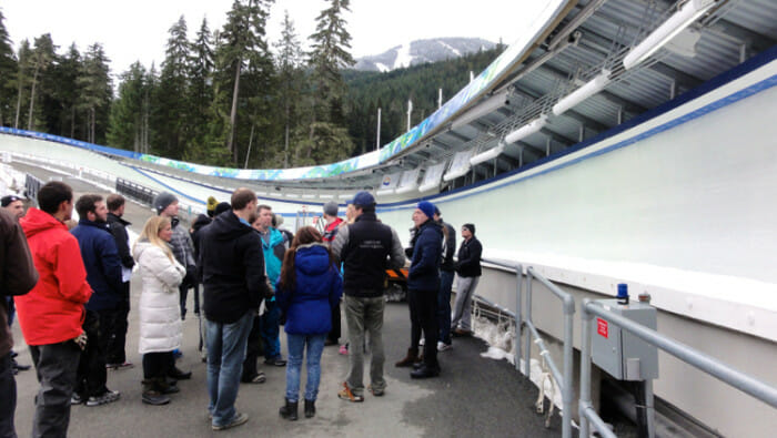 There was a large group of us. Three went in each bobsleigh with a pilot. Here they're getting more a good look at the course and a better idea of what it will be like from Philippe.