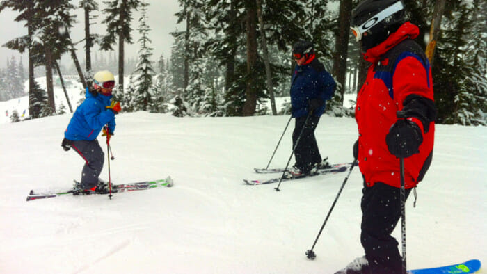 Junko demonstrating how she wanted our bodies positioned over our skis.
