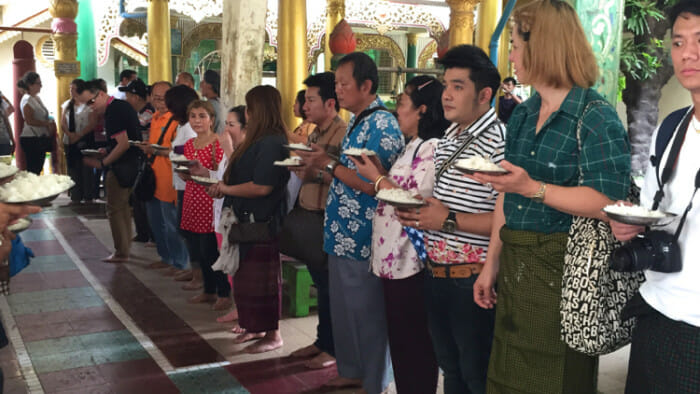 People waiting for the monks to give them rice and gifts