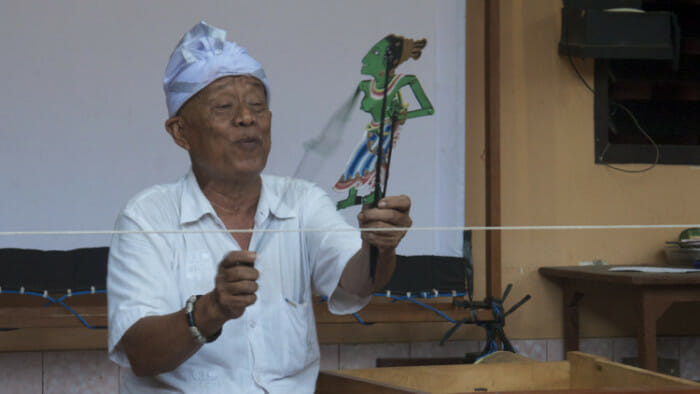 Shadow puppets, or wayang, is the most popular form of theater in Bali. Here the puppet master is at work.