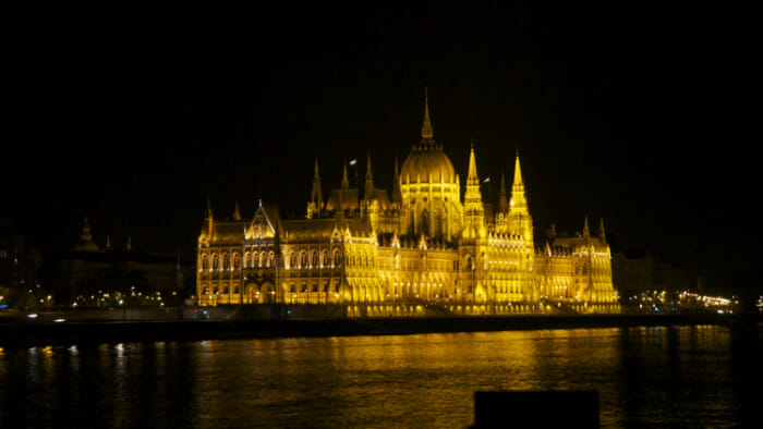 Like many buildings in Budapest, the Hungarian Parliament buildings are lit up at night.