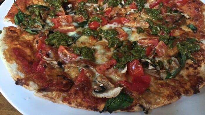 A photo never does a pizza justice. This pizza at the Station Bar us yummy!