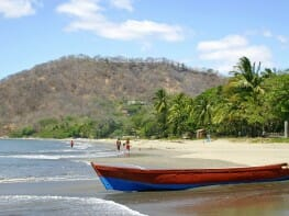 Playa Hermosa beach in Costa Rica  with a boat in the foreground