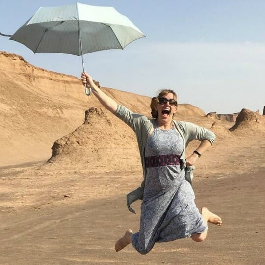 photo, image, woman with umbrella, desert, iran