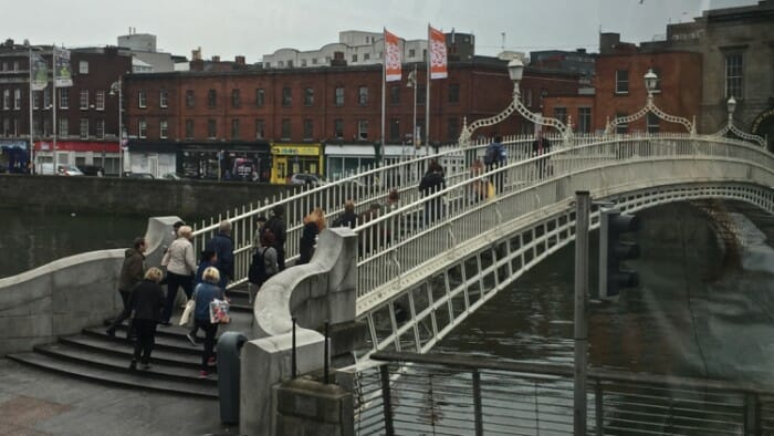 The Ha'penny bridge spans the River Liffey.