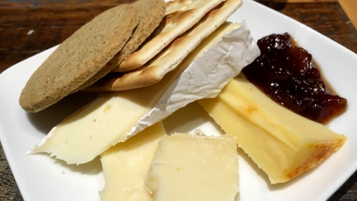 Between 5 and 8pm they offer a free glass of wine and some really wonderful cheeses. Help yourself!