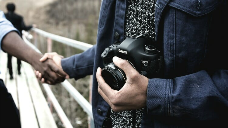 photo, image, locals help solo travelers, handshake