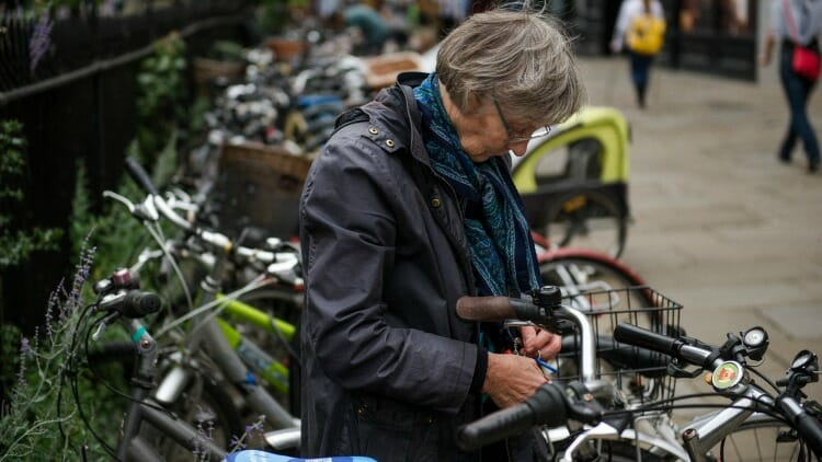 photo, image, woman and bike, senior solo travel