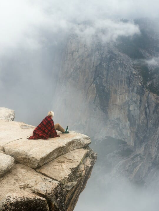 photo, image, woman on cliff, senior solo travel