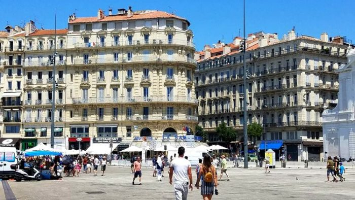 people strolling, marseilles, france photos