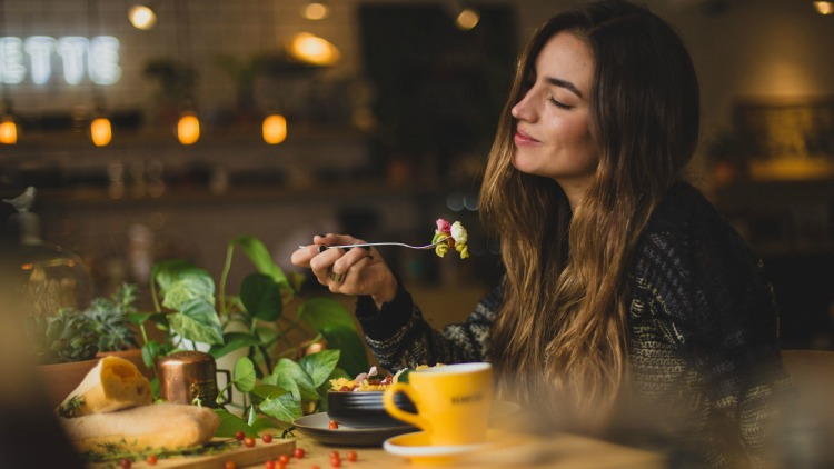 photo, image, woman dining alone, stress-free solo travel
