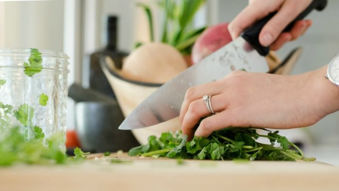 chopping herbs, save money for travel