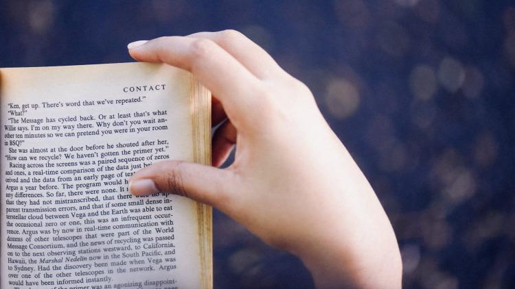 book, hand, choosing a travel destination