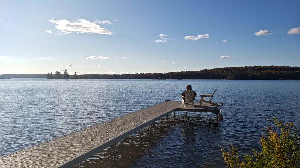 Woman on dock travel to cottage country