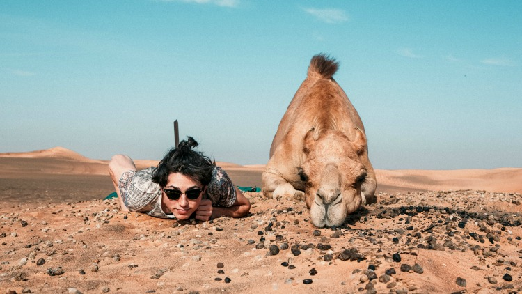 woman with camel, what traveling alone teaches us